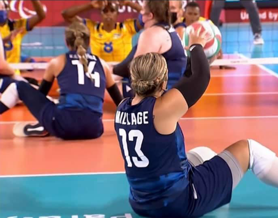 Nichole makes a sitting volleyball play